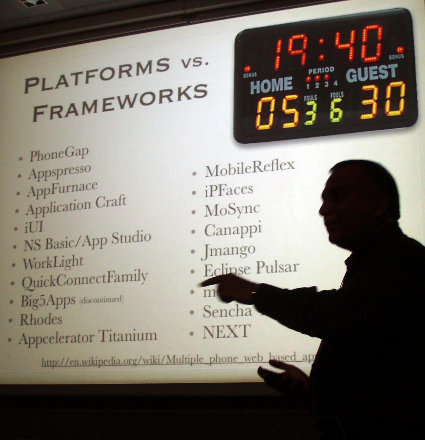 Local.ch's Vikram Kriplaney speaking about mobile platform vs. frameworks at Mobile Monday Zurich